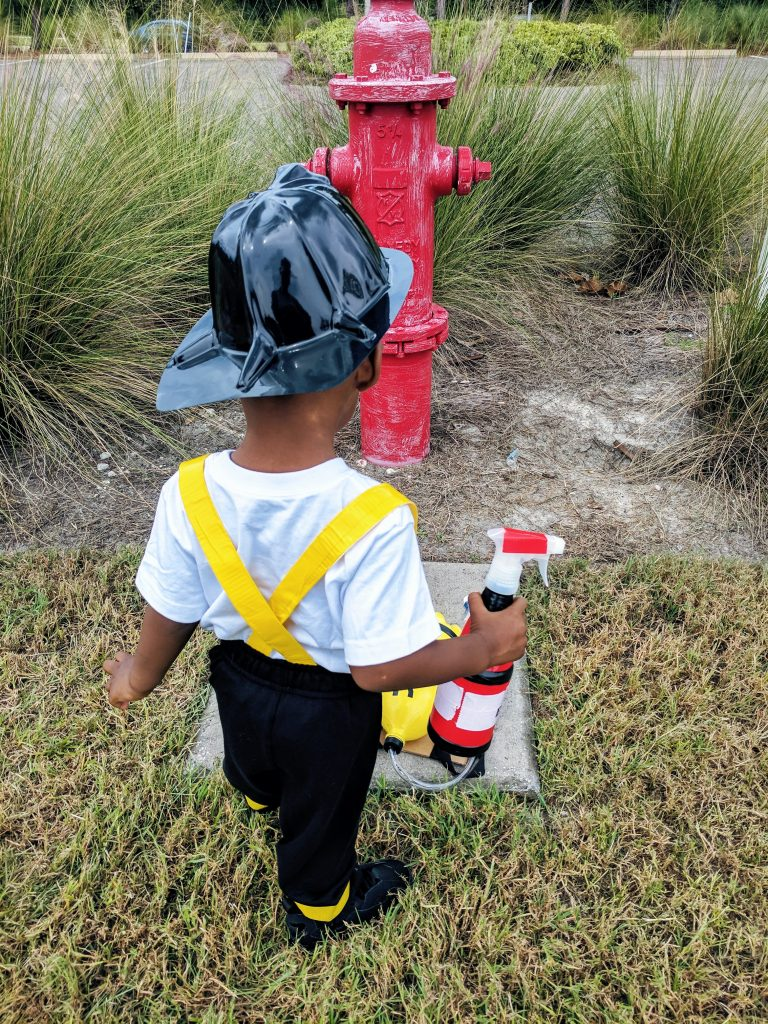 The Best DIY Firefighter Costume for kids that is perfect for Halloween or dramatic play