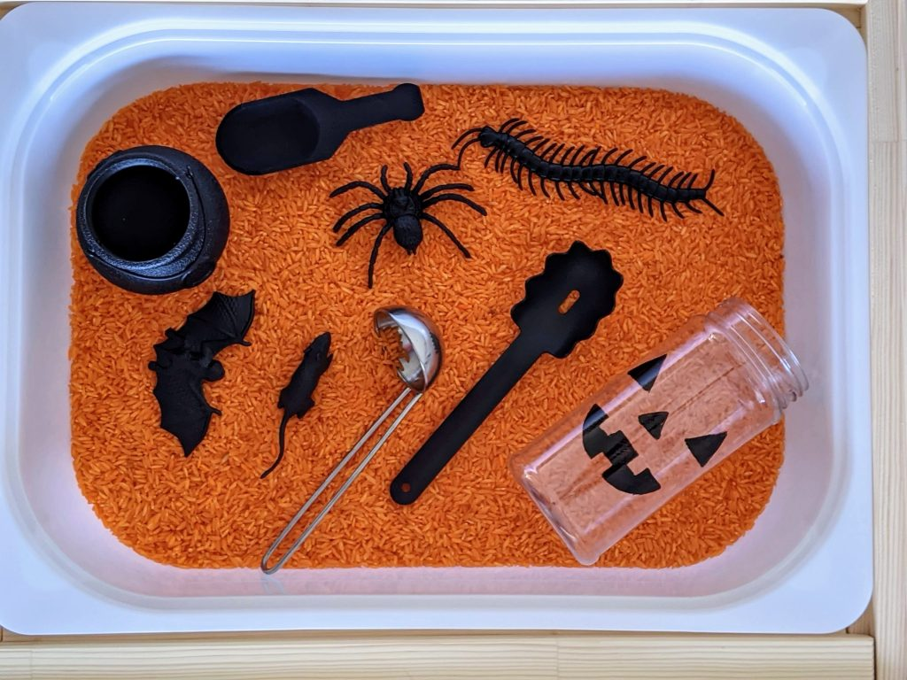 Spooky Halloween sensory bin for kids with colorful rice