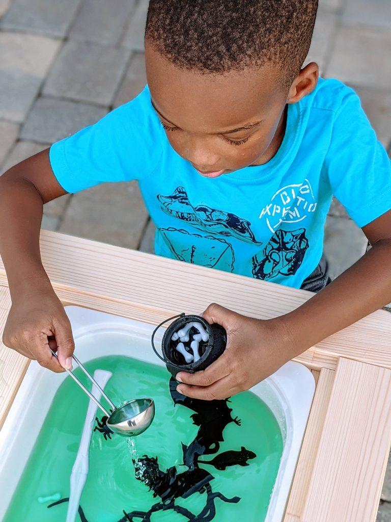 Kindergartner playing enjoying water sensory activity