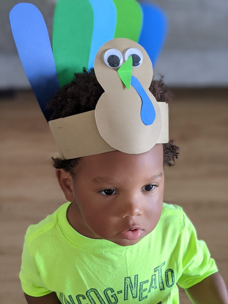 amazing Thanksgiving crafts featuring a DIY turkey hat for kids