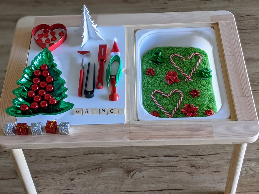 Grinch sensory bin for toddlers, preschoolers and older children. Fun Christmas hands-on learning activity.
