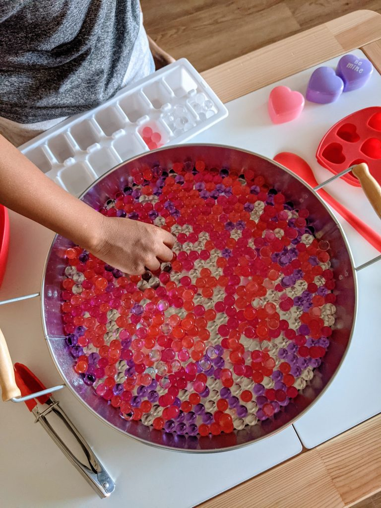 Valentine's Day sensory tray filled with water beads