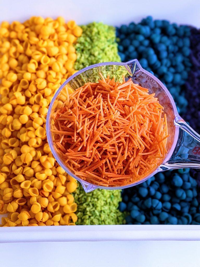 colorful rainbow pasta sensory bin